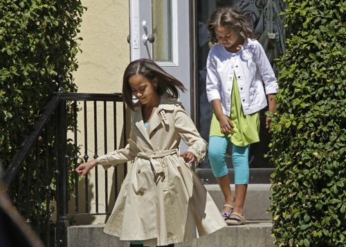 President Barack Obama's daughters, 10-year-old Malia, left, and 7-year-old Sasha, emerge from St. John's Church across from the White House, where th...