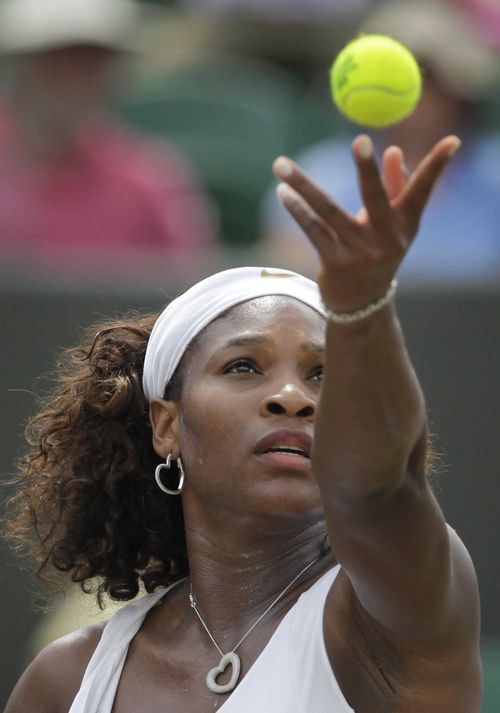 Serena Williams, of the U.S., serves to Daniela Hantuchova, of Slovakia, during their fourth round singles match at Wimbledon, England on Monday.
