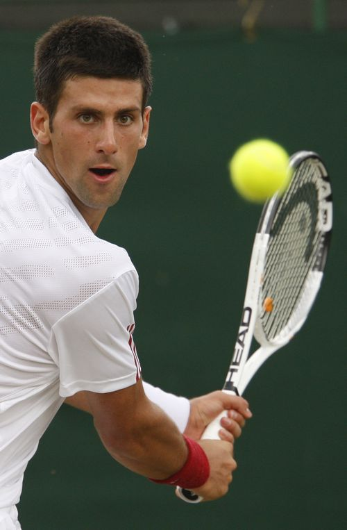 Novak Djokovic, of Serbia, returns to Dudi Sela, of Israel, during their fourth round singles match at Wimbledon, England on Monday.