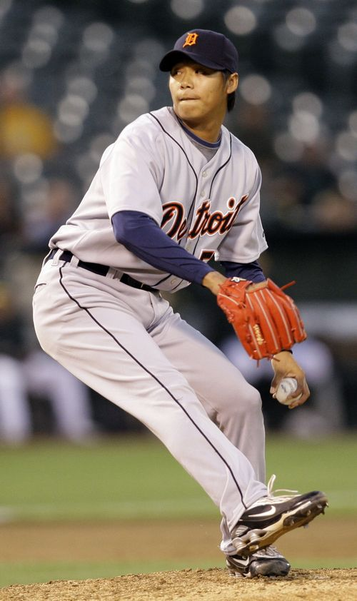 Detroit Tigers left-handed reliever Ni Fu-te, of Taiwan, works against the Oakland Athletics in the 5th inning of a game in Oakland, California yester...
