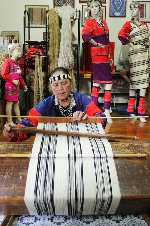 Seediq Tribe aborigine Bagan-Narwee weaves with a traditional weaving machine at the Alang Snuwil area, Renai Township, Nantou County.