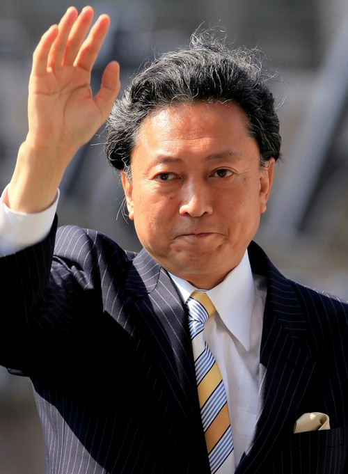 Japan's main opposition Democratic Party of Japan leader Yukio Hatoyama, a strong contender to become the next prime minister, greets supporters as he...