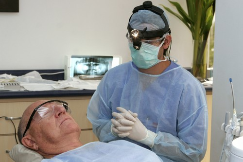 Costa Rican Dr. Luis Obando, right, prepares to perform a root canal on Bill Jones, of Dallas, Texas, at Meza Dental Care in San Jose, Costa Rica on J...