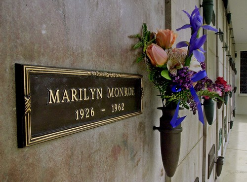 In this April 2001 file photo, a bouquet of fresh flowers adorns the crypt of movie star Marilyn Monroe at Westwood Village Memorial Park Cemetery in ...