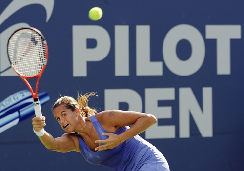 Amelie Mauresmo, of France, stretches for a forehand during her 6-4, 6-1 victory over Ai Sugiyama, of Japan, at the Pilot Pen tennis tournament in New...