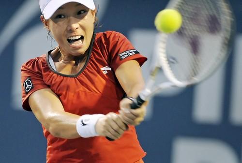 Zheng Jie, of China, hits a backhand return during the first set of her first-round match against Svetlana Kuznetsova, of Russia, at the Pilot Pen ten...