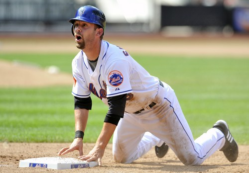 New York Mets' Cory Sullivan looks up to see he is called out after diving back to first base too late as he was doubled up on a line drive hit by And...