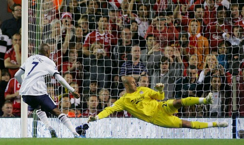 Aston Villa's Ashley Young beats Liverpool goalkeeper Pepe Reina, right, to score during their English Premier League soccer match at Anfield, Liverpo...