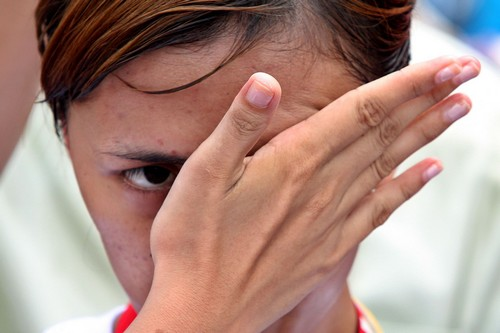 An aboriginal girl wipes her eyes during a protest held yesterday by villagers from Namaxia Village, Kaohsiung County in front of the Presidential Off...