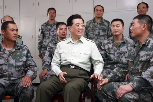 In this photo taken on Saturday and released by China's Xinhua News Agency on Tuesday, Chinese President Hu Jintao, center, talks with military office...