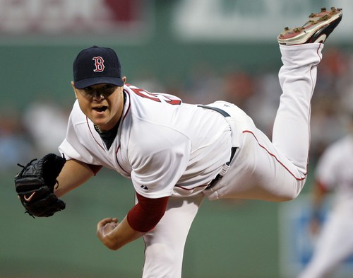 Boston Red Sox starter Jon Lester delivers to the Chicago White Sox in the first inning of a baseball game at Fenway Park in Boston, Massachusetts on ...