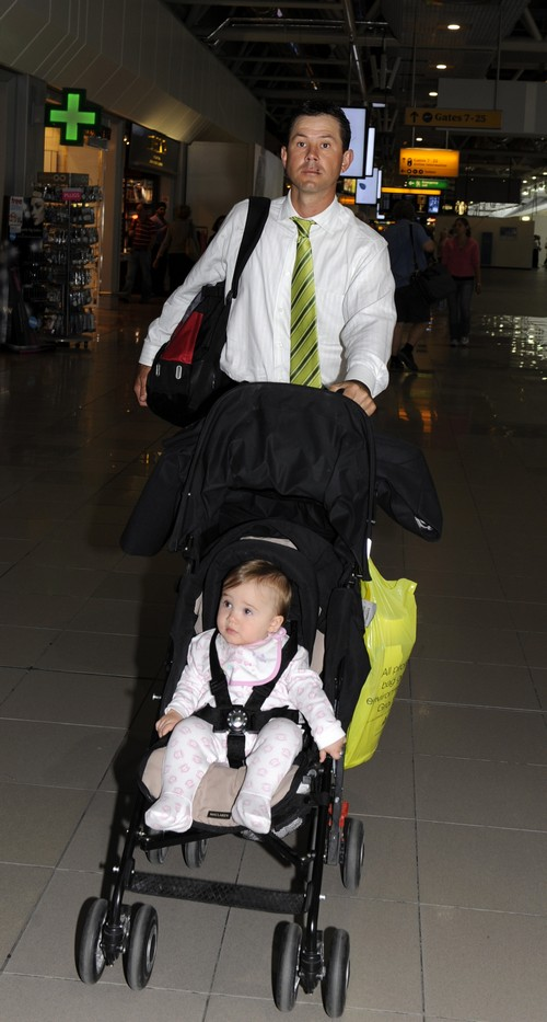 Australian cricket captain Ricky Ponting pushes his daughter Emmy Charlotte to his Qantas flight before returning home to Australia on Tuesday.