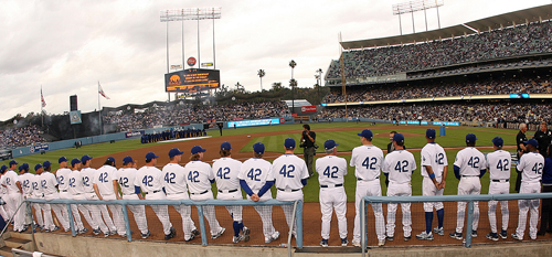 The Los Angeles Dodgers line up as they pay tribute to Jackie Robinson by wearing his number, 42, before the Dodgers baseball game against the San D...