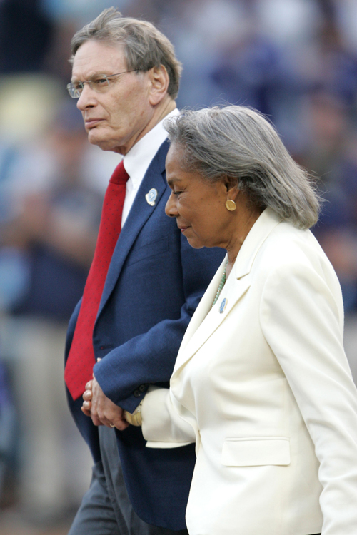 Major League Baseball Commissioner Bud Selig walks to the pitcher's mound with Rachel Robinson, widow of Jackie Robinson, before the start of the San ...