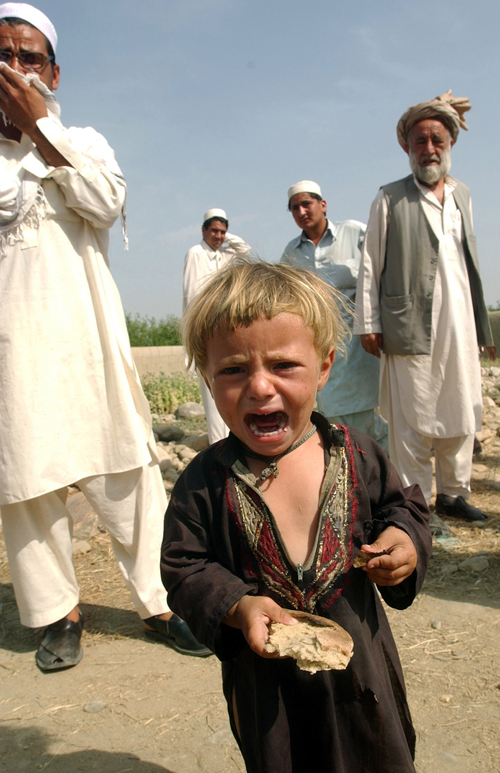 An Afghan boy cries after his parents were alledgedly killed during a U.S. raid in Bati Kot area of Nangarhar province, east of Kabul, Afghanistan on ...