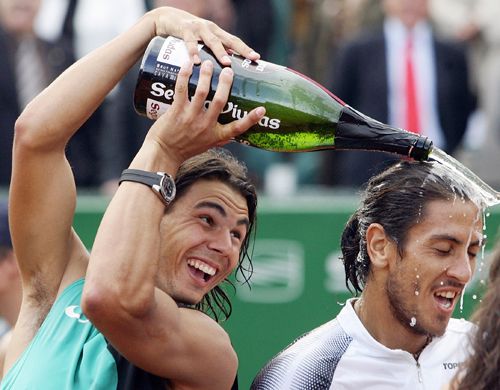 Rafael Nadal of Spain pours champagne over Guillermo Canas of Argentina after their final Open tennis match in Barcelona, Spain on Sunday.