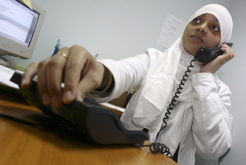 A Muslim woman makes a phone call in Paris, France in this file photo. French doctors said there are more and more women seeking hymenoplasties in rec...
