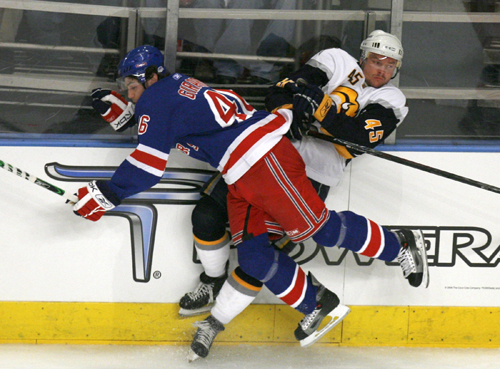 New York Rangers defenseman Dan Girardi, front, checks Buffalo Sabres defenseman Dmitri Kalinin into the boards during the first period of Game 3 of t...
