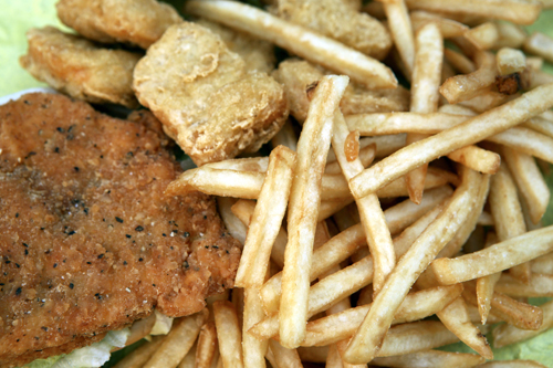 McDonald's chicken sandwich, left, chicken nuggets, center, and fries are seen in this file photo, prior to the company's 