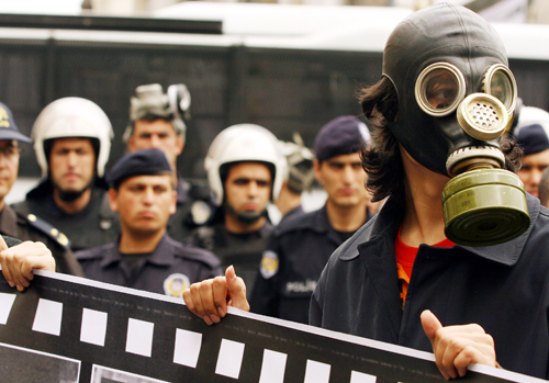 A Turkish university student wears a gas mask during a demonstration to protest against the country's current political crisis in downtown Istanbul, T...