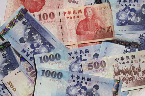 New Taiwan dollar bills in different denominations are arranged for a photograph in Taipei earlier this month.