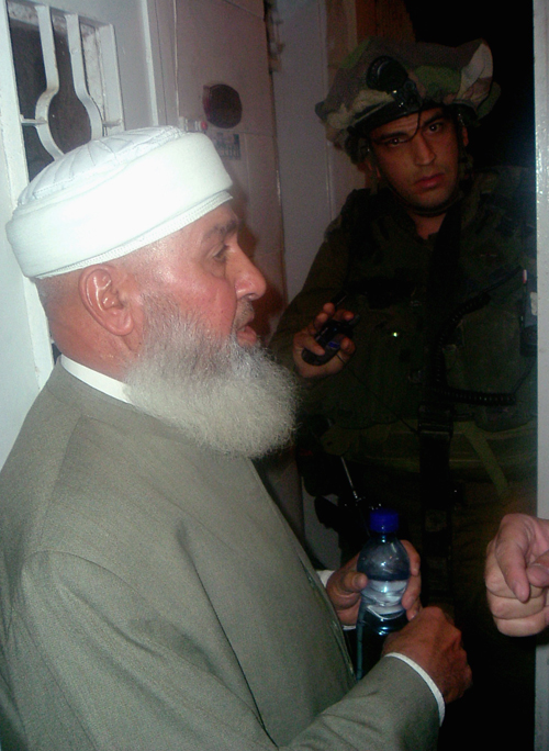 Palestinian Hamas lawmaker Hamed Bitawi, left, is detained by Israeli soldiers in Nablus, West Bank yesterday.
