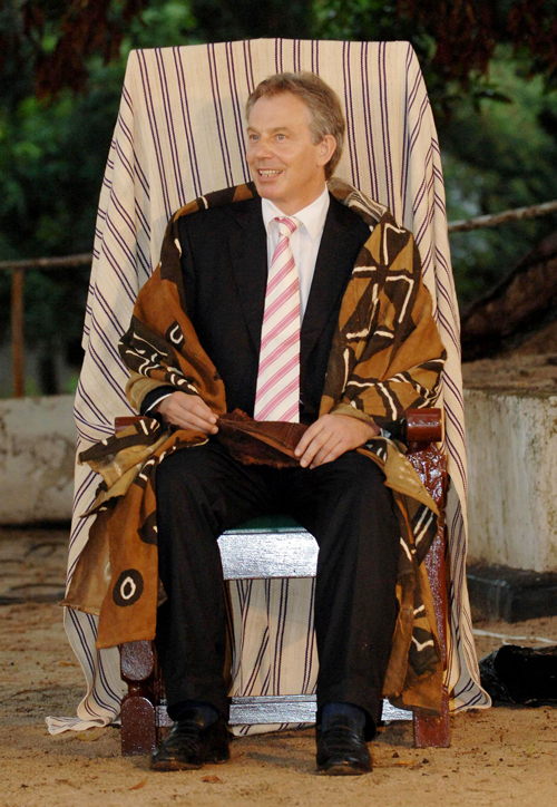 British Prime Minister Tony Blair is made an honorary Paramount Chief in Mahera, Sierra Leone on Wednesday.