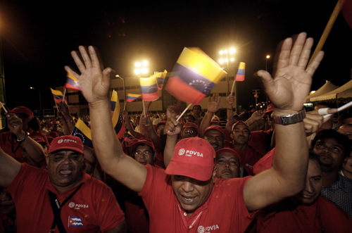 Workers of Venezuela's state-run oil company PDVSA, shout out slogans in support of Venezuela's President Hugo Chavez and Cuba's acting president Raul...