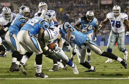 Dallas Cowboys running back Marion Barber (24) splits Carolina Panthers defenders to score a touchdown on a 5-yard run during second quarter NFL  acti...