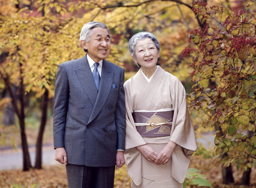 Japan's Emperor Akihito and Empress Michiko take a stroll in the East Gardens of the Imperial Palace in Tokyo on December 7 in this photo released by ...