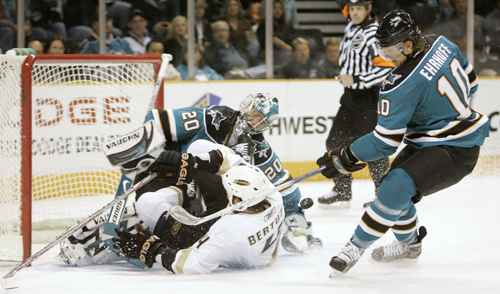 Anaheim Ducks right wing Todd Bertuzzi, center, collides with San Jose Sharks goalie Evgeni Nabokov, left, of Kazakhstan, as defenseman Christian Ehrh...
