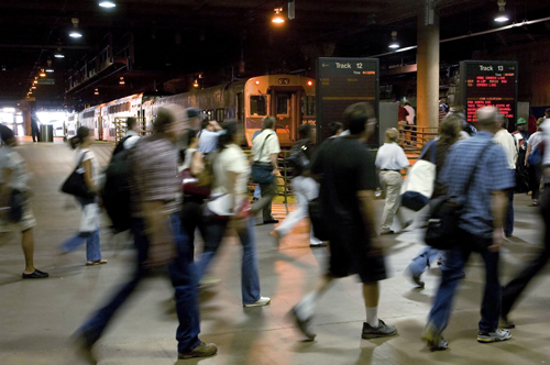 Passengers run along the platform to catch waiting Amtrak trains at Union Station in Washington, D.C. in this August 2006 file photo. Amtrak is likely...