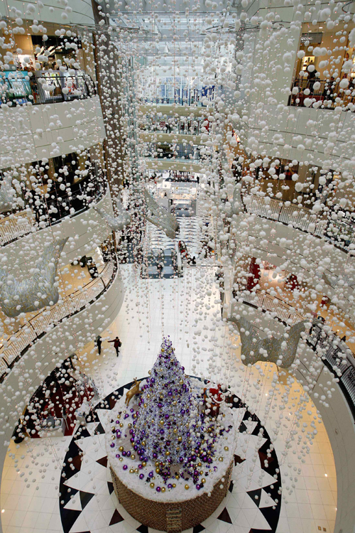 Christmas decorations are seen at a shopping mall in Shanghai on Friday. China's shopping malls in late December leave little doubt that the country h...