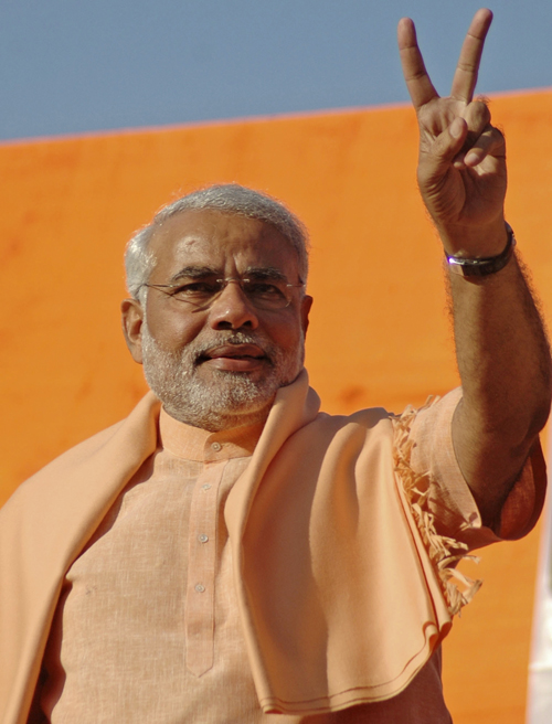 Gujarat state Chief Minister Narendra Modi shows victory sign to party workers in Ahmadabad, India yesterday.