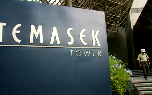 A man walks out of the Temasek Tower in Singapore in this file photo. Temasek says its net portfolio worth is now more than US$100 billion.