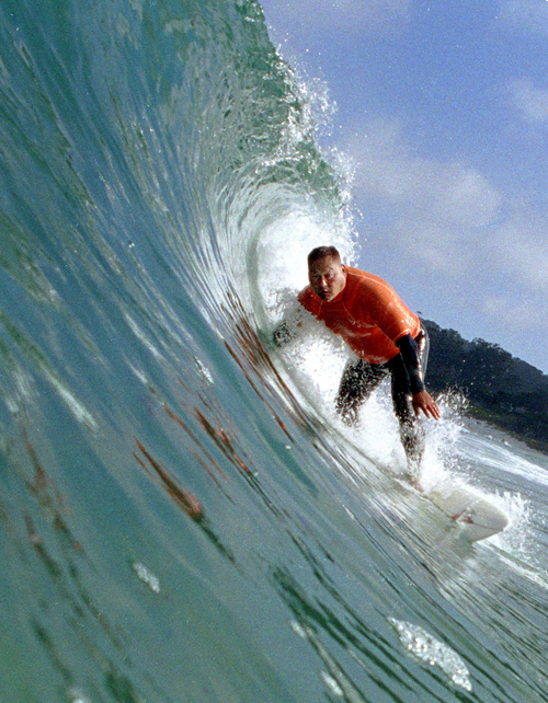 Ken Shin is seen surfing at Carmel, California in this file photo. Global warming expected to change some of landscapes, activities that make Californ...