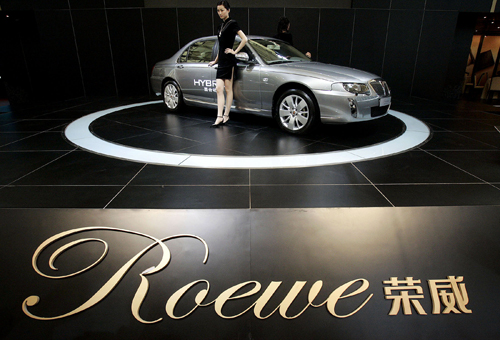 A model stands next to the Roewe, Chinese automaker SAIC Motor Corp.'s own brand of car, at a car show in Shanghai in this file photo.