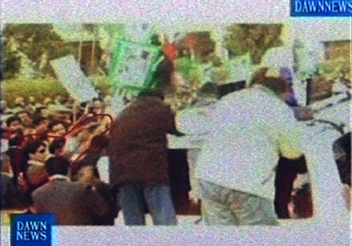 Two video frame grabs from an amateur video obtained by Dawn TV show images from the moments leading to Benazir Bhutto's assassination. The top image ...