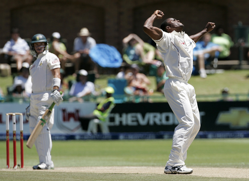 West Indies' Daren Powell, celebrates his dismissal of South Africa's Herschelle Gibbs on the fourth day of their first test cricket match in Port Eli...