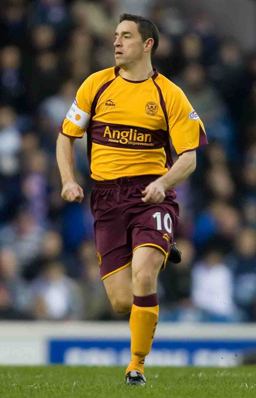 Motherwell's Phil O'Donnell runs during his Scottish Premier League soccer match against Rangers in Glasgow in this December 26 file photo.