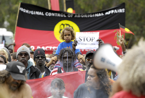 Aboriginines protest on the lawns of Parliament House in Canberra yesterday. About 500 protesters, including many Aborigines, marched to Parliament Ho...