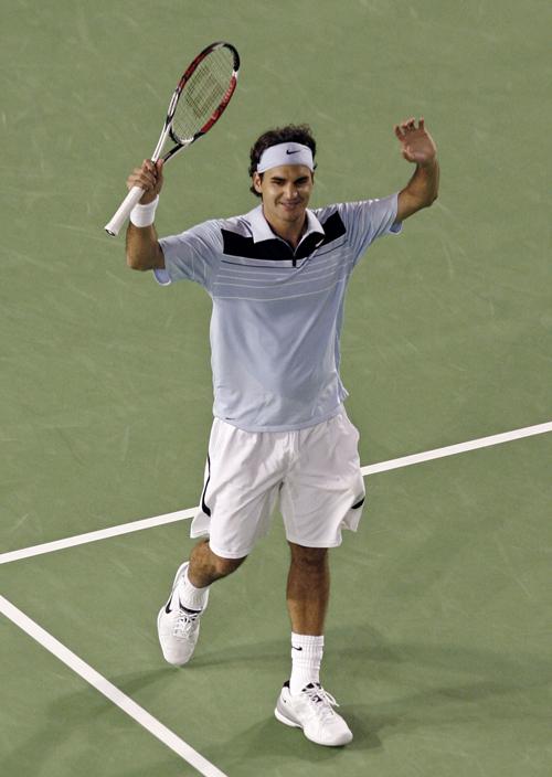 Roger Federer celebrates winning his semi-final match against Andy Roddick at the Australian Open tennis tournament in Melbourne, Australia yesterday....