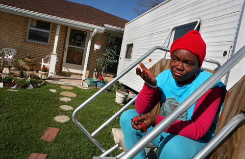 Elvira Robertson, frustrated with the pace of recovery  and support to homeowners, and her husband moved back home and  have been living in a FEMA tr...