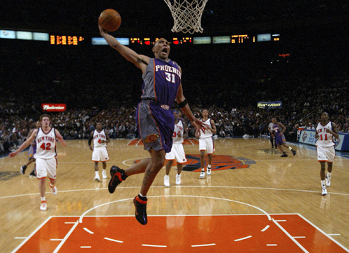 Phoenix Suns' Shawn Marion sails to the basket for a dunk against the New York Knicks in New York, New York on Wednesday.
