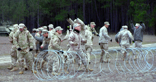 Airmen pretending to be rioters scatter after being zapped by a new military ray gun during a demonstration at Moody Air Force Base, Georgia, on Wedne...