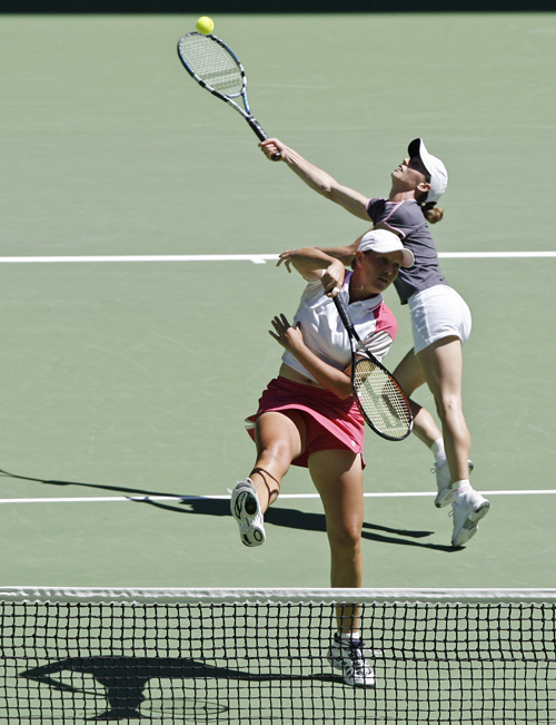 South Africa's Liezel Huber, left, and Zimbabwe's Cara Black play the ball in Melbourne, Australia yesterday.