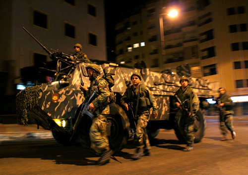 Lebanese army soldiers and an armored personnel carrier arrive in the area were confrontation erupted between Government and opposition supporters in ...