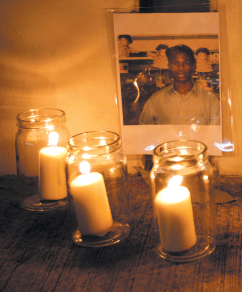 Candles are placed around a portrait of Iwuchukwu Amara Tochi during a vigil held for him outside the Singapore Changi prison yesterday.