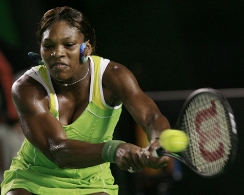 Serena Williams of the U.S. returns a backhand to a dispirited Maria Sharapova  during the women's final at the Australian Open tennis tournament in M...