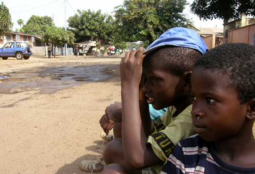 Children sit on a street in Guinea's capital Conakry on Friday.